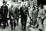 19th May 1953 - Duke of Edinburgh crossing Canbury Park Road to go from the factory to visit the Design Department.