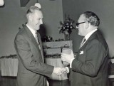George Cottrell (left) receiving his 25 year service clock from Mr. Rubython, Hawker Aircraft Director, 1959.